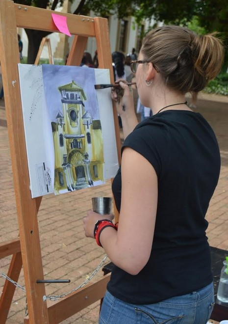 A Member of the South College putting some final touches to her painting.