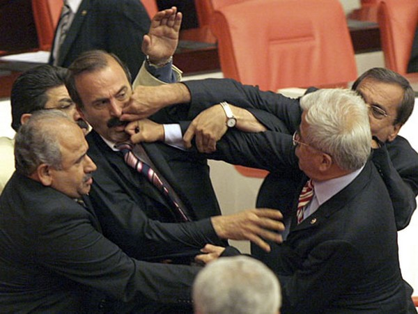 Turkish MPs fight during a debate in the Turkish parliament in Ankara