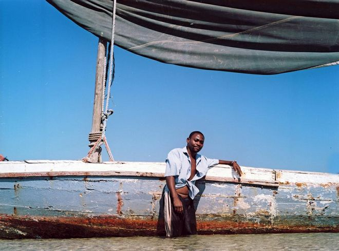 "Asking permission and getting to know your subjects. This is Raphael posing next to his Dhow boat. ""I tell them why I want to take their photo and where I hope to use it and why - and if they agree I take it, says Smith.  Photo:  Sydelle Willow Smith"