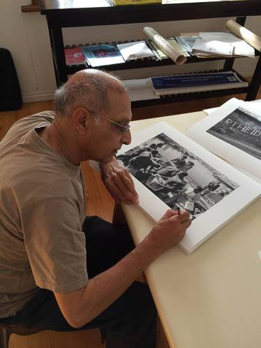 Omar Badsha working on exhibition