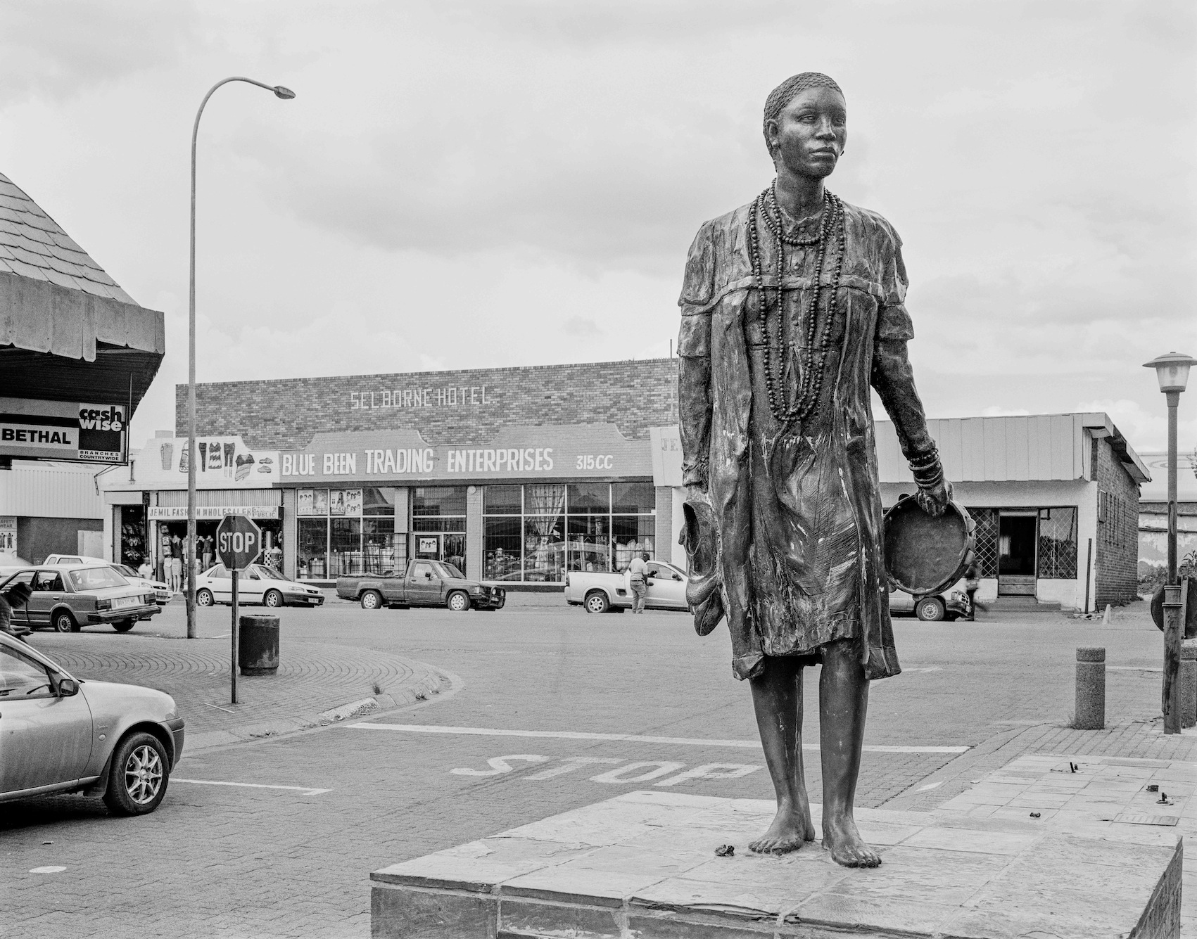 "Photograph by David Goldblatt, Memorial to Nokuthula Simelane, who became a courier for the ANC. Trapped by the Security Police in 1983, she was severely tortured, then murdered and disappeared. The sculpture is by Rohan Janse van Vuuren, Bethal. 14 February 2014.  Image courtesy of the artist and Goodman Gallery. For some 32 years her family have tried to discover where her remains were buried or destroyed. Hers is one of many cases in which the ANC government appear to have hindered prosecution of known murderers in the Security Police. (See ""Sunday Times"" May 24 2015) Corne van Tonder vandalised the sculpture, was fined R15000 and ordered to pay R214000 for its repair."