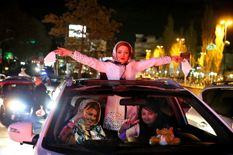 Iranian women celebrating in their sports car after the historic nuclear deal with the US in July.