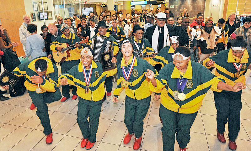 The Riel Dancers arriving at the airport after winning the World title at the International Performing Arts Championships. The colonialists treated them as less than human all those many years ago.