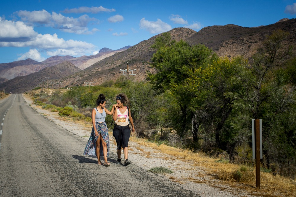 Sarah Summers greets her partner Kelly-Eve Koopman on the road after her walk along the R407 towards Prince Albert from Willowmore, Western Cape, South Africa, February 22, 2017. Koopman and Summers are creators of the Coloured Mentality web series and are making a documentary about the walk. Photo: Jane Berg.