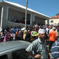 Crowds gathered outside the house