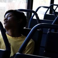 Anelisa falls asleep on the 7am bus, exhausted from days of fire fighting.